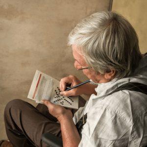 beehivehomes-senior-doing-crossword-puzzle